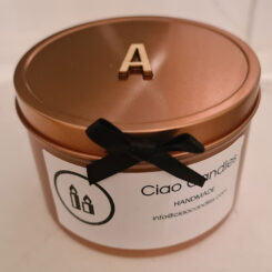 Candle with wooden initials on lid